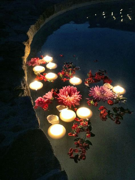 Floating flowers and candles in the fountain added a touch